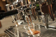 Espresso being prepared from coffee machine Stock Photos