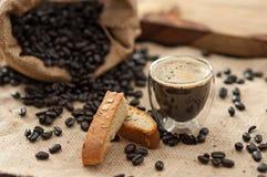 Espresso, Biscotti and Coffee Beans. Espresso , Biscotti and Coffee Beans on burlap royalty free stock photography