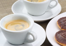 Espresso and biscuits Stock Photography
