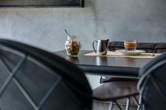 Espresso on black glossy table Stock Photos