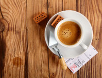 Espresso, Bricks, Trowel and Blueprint on a Table Royalty Free Stock Photos