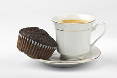 Espresso with chocolate cake. Cup of espresso with chocolate cake on white background royalty free stock photography