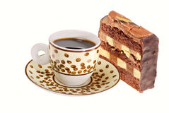 Espresso and chocolate cake isolated on white. Espresso in a cup with coffee beans pattern and a piece of chocolate cake, isolated on white royalty free stock photo