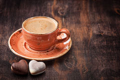 Espresso with chocolate candies. Cup of coffee Royalty Free Stock Photos