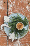 Espresso and christmas cookies on plate with christmas wreath made from pine twigs on wooden table Stock Photos