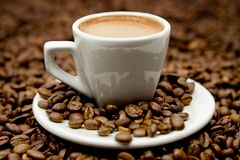 Espresso on Coffe Beans Royalty Free Stock Photography
