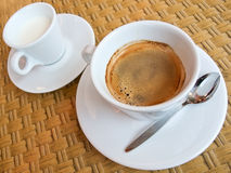 Espresso coffee. And small jug of milk Royalty Free Stock Image