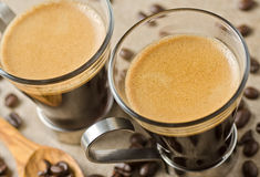 Espresso Coffee. Freshly brewed espresso coffee with roasted coffee beans Stock Photography
