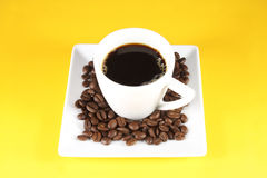 Espresso and coffee beans Stock Images