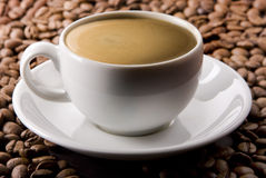 Espresso on Coffee Beans Stock Photography
