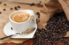 Espresso and Coffee Beans. In burlap satchel Royalty Free Stock Images