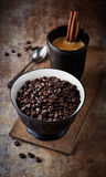 Coffee beans in a bowl and a mug of coffee Royalty Free Stock Photos