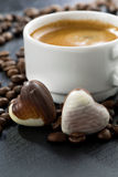 Espresso, coffee beans and chocolate candies in a heart shape Royalty Free Stock Image
