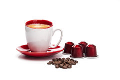Espresso with coffee beans and pods Stock Image