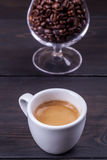 Espresso and coffee beans Royalty Free Stock Image