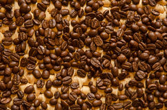 Espresso coffee beans on a woven tray. Background of roasted espresso coffee beans on a woven bamboo serving tray Royalty Free Stock Photography