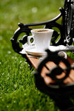 Espresso coffee on a bench in a park Stock Images