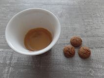 Espresso coffee and biscuits on a wooden grey surface stock photos