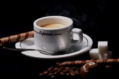 Espresso coffee break. Hot Cup of coffee with sweet candies stock photography