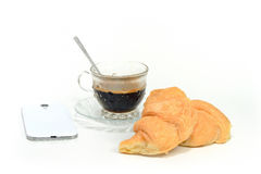 Espresso coffee in classic cup  with croissant and cellphone  is Stock Image