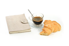 Espresso coffee in classic cup with croissant and diary book iso Stock Photo