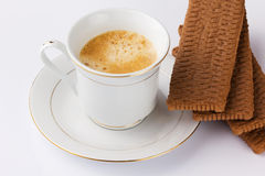 Espresso coffee and cocoa biscuits. On a white background royalty free stock images