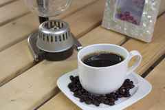 Espresso coffee and coffee beans. Close up of espresso coffee cup and coffee beans Stock Photography