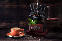 Espresso coffee and coffee grinder Royalty Free Stock Photography