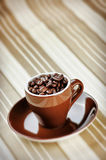 Espresso Coffee Cup with Beans Royalty Free Stock Images