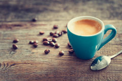 Espresso coffee cup with beans on wooden board. Stock Photo