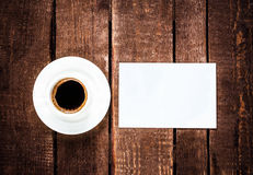 Espresso Coffee cup and blank business card on wooden table. Whi Royalty Free Stock Photo