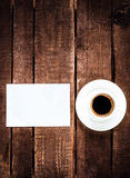 Espresso Coffee cup and blank business card on wooden table. Whi Royalty Free Stock Image
