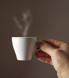 Espresso coffee cup. On brown background Royalty Free Stock Images