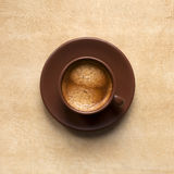 Espresso coffee cup. Espresso cup on brown texture. One coffee color Stock Photo