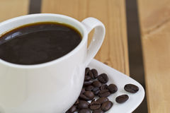 Espresso coffee cup and coffee beans. Close up of espresso coffee cup and coffee beans Royalty Free Stock Images
