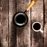 Espresso Coffee cup and Coffee pot over wood table top view. Royalty Free Stock Images