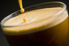 Espresso coffee cup with cream Royalty Free Stock Photos