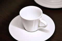 Espresso coffee cup. Empty espresso coffee cup with a plate Stock Images