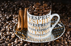 Espresso coffee cup in an environment of fried coffee grains Stock Image