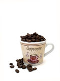 Espresso Coffee Cup Filled With Coffee Beans. An espresso coffee cup full of coffee beans on a white background Royalty Free Stock Photography