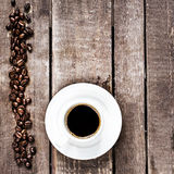 Espresso Coffee cup and roasted  coffee beans on old wooden tabl Stock Photography