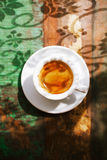 Espresso coffee cup on rustic table with sun Stock Image