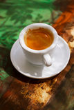 Espresso coffee cup on rustic table with sun Royalty Free Stock Photography