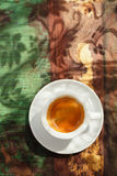 Espresso coffee cup on rustic table with sun Stock Images