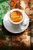 Espresso coffee cup on rustic table with sun Royalty Free Stock Images