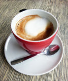 Espresso coffee cup and spoon closeup shot Royalty Free Stock Photography