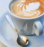 Espresso coffee cup and spoon closeup shot Royalty Free Stock Images