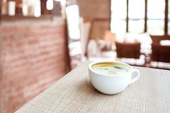 Espresso Coffee cup on wood table in cafe with blur coffee shop. Background, Leisure lifestyle concept Royalty Free Stock Image