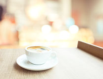 Espresso Coffee cup on wood table in cafe with bokeh light backg Stock Images
