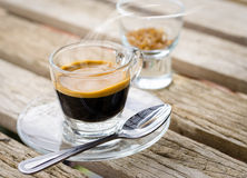 Espresso coffee  cup on wooden table Royalty Free Stock Images